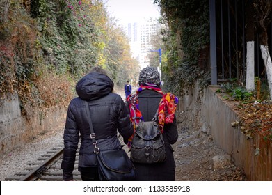 Two sisters are walking on the railway (Kunming, Yunnan, China)