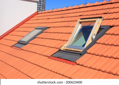 Two skylights fitted to the roof of burnt roofing