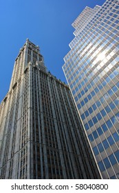 Two skyscrapers of different eras are proudly standing under the New York sun.
