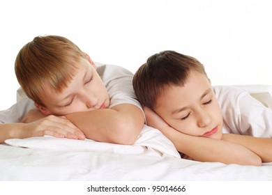 two sleeping boys on the floor