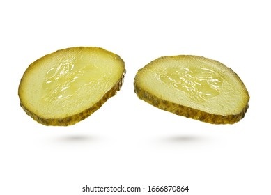 Two sliced green pickles isolated on white background with clipping path