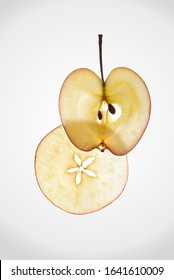 two slices of apple in the background light on a white background