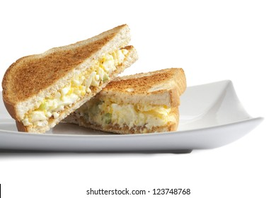 Two slices of breakfast sandwich with egg on a plate