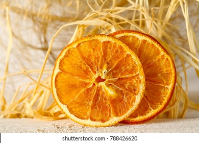 Two slices of dried orange fruit
