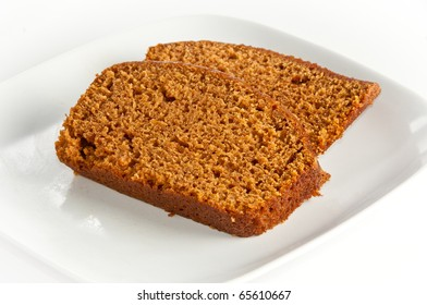 Two slices of freshly baked pumpkin bread on white isolating background