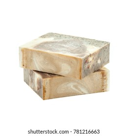 Two slices of handmade organic soap isolated from background