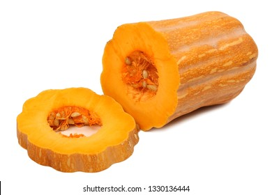 Two slices of pumpkin with the seeds still in
