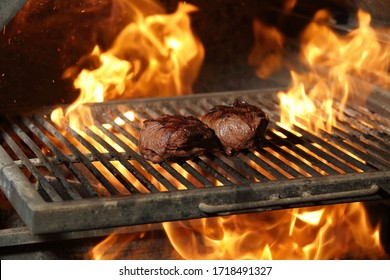 two slices of ribeye grill steak on fire