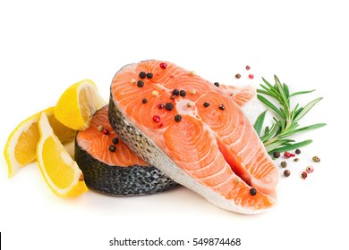 Two slices trout fillet with spices, lemon and rosemary isolated on white background