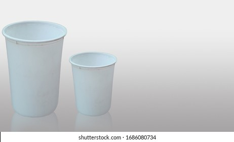 two small and big size white empty cups are kept isolated