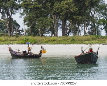 Two small boats at Smart Island outside Myeik, a part of the Mergui or Myeik Archipelago in the Tanintharyi Region of Southern Myanmar.