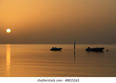 Two  small boats at sunset