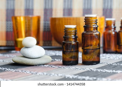 Two small bottles with essential oils. Aromatherapy, spa and herbal medicine concept. Copy space.