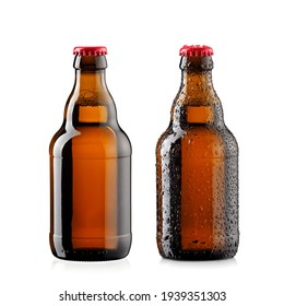 Two small brown beer bottles with and without drops