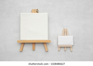 Two small canvases on the easels.