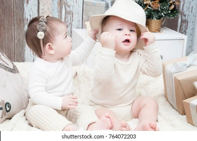 Two small children, a boy and a girl in natural cloth diapers, natural swaddling, eco-friendly cotton fabrics