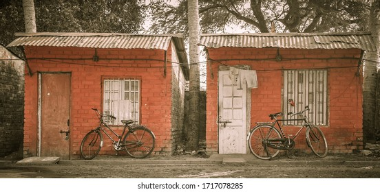 two small houses with bikes