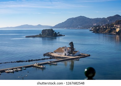Two small islands, Vlaherna and Mouse Island with Christian churches in Corfu, Kerkyra, Greece, sunny spring day view from high above with blurred fence decoration and blue waters Ionian Sea