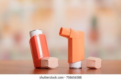Two small pocket inhaler to relieve an asthma attack, located on table