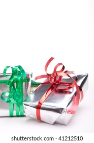 Two small shiny christmas presents isolated against white background.