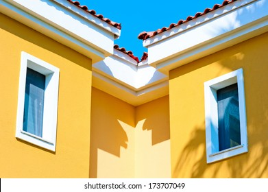 two small windows in the attic under the roof