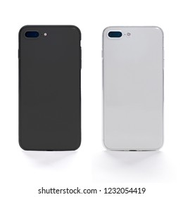 Two smart phones back view in black and white color in transparent silicone cases. Template of transparent phone case