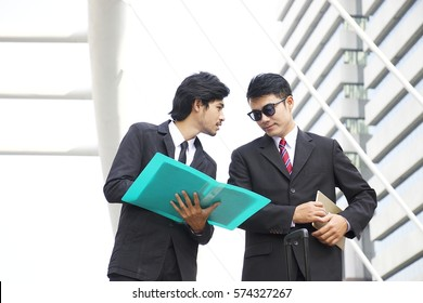 Two smart worker manager is discussing outside office