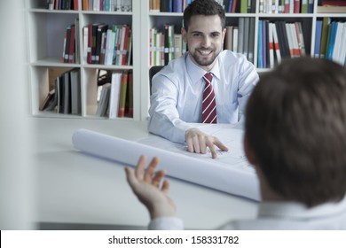 Blueprint china images stock photos vectors shutterstock two smiling architects discussing over a blueprint malvernweather Gallery