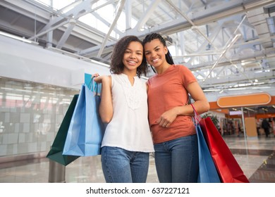Two Smiling Black Girlfriends at Shopping Mall