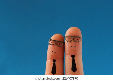 Two smiling business men - successful teamwork - funny finger people