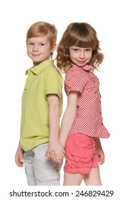 Two smiling children against the white background