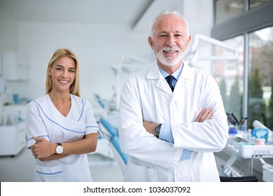 Two smiling dentists in a dental office, professional dental team