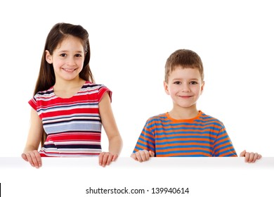 Two smiling kids standing with empty horizontal blank in hands, isolated on white