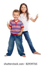 Two smiling little children with thumbs up sign, isolated on white