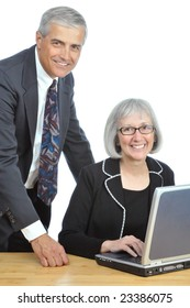 Two Smiling Mature Business People with Laptop Computer isolated over white