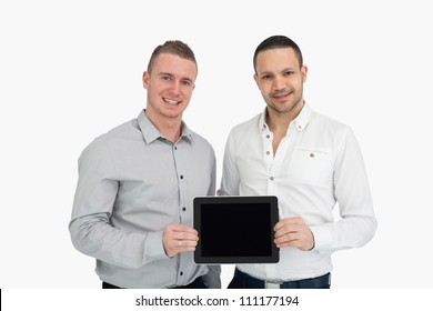 Two smiling men holding a tablet computer against a white background