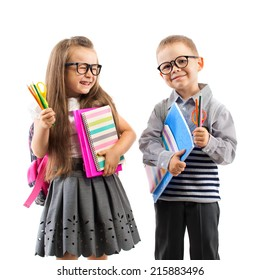 Two smiling school kids with colorful stationery, isolated on white background. School, education concept.