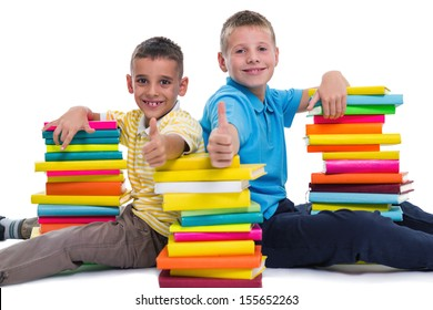 two smiling schoolboys showing thumbs up gesture