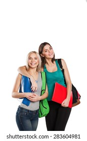 Two smiling students girl posing isolated on white background