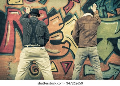 Two snazzy stylish men relieve themselves in public