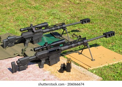 Two sniper rifles .50 BMG caliber on shooting range. With .50 BMG cal. (Browning Machine Gun) was made second longest kill in military history at 2,430 meters (2,657 yards) during the Afghanistan War.