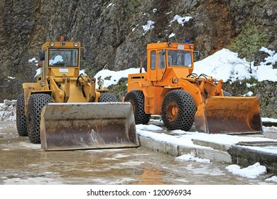 Two snow mover diggers for winter road maintenance