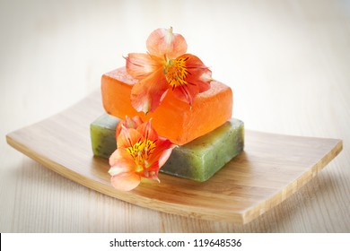 Two soap bars with natural ingredients