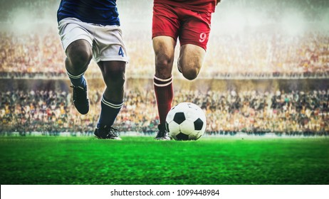 Two soccer football player dribbling a ball during match in the stadium