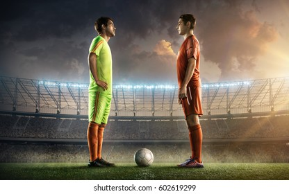 two soccer players face to face