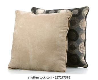 Two sofa pillows covered in neutral fabrics