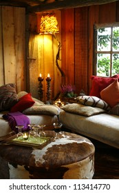 Two sofas and a table in cozy country house