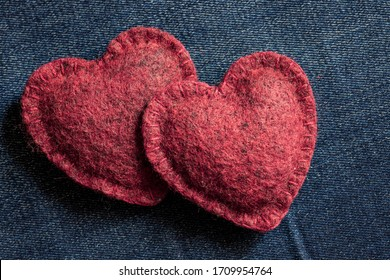two soft hearts together on a jeans background, a romantic concept of love and long happiness together with your beloved partner