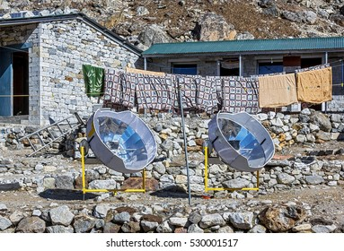 Two solar oven apply in the Lobuche village for cooking on a sunny day - Everest region, Nepal, Himalayas