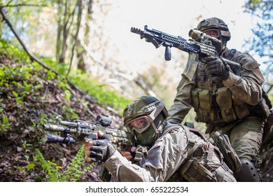 Two soldiers aim at target
